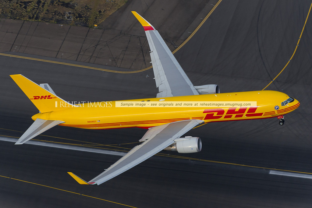 Polar Air Cargo DHL N644GT seen from the air at Sydney airport. Has commenced takeoff, and we are chasing it down the eastern side of the runway. It has now lifted off and is climbing quickly.