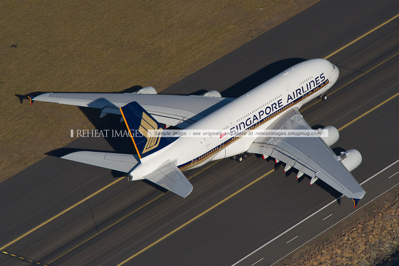 An overhead view of Singapore Airline's Airbus A380-841 as it heads out to runway 34 left.