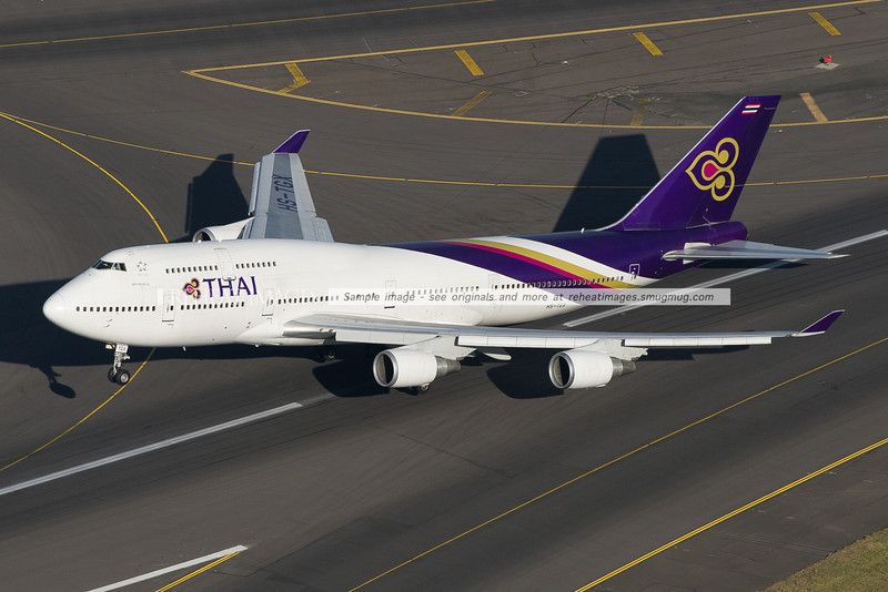 Thai Boeing 747-4D7 lifts off from runway 34 left