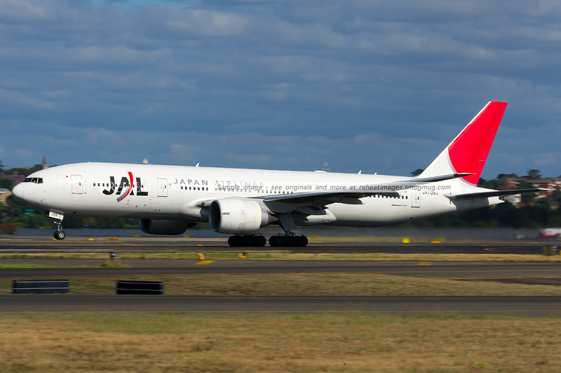 A Japan Airlines Boeing 777-246/ER departs from Sydney airport on runway 16 right.