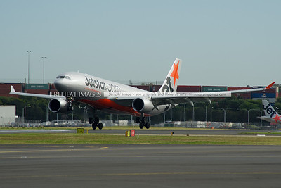 A Jetstar A330-200 Airbus slows down on runway 16 right.