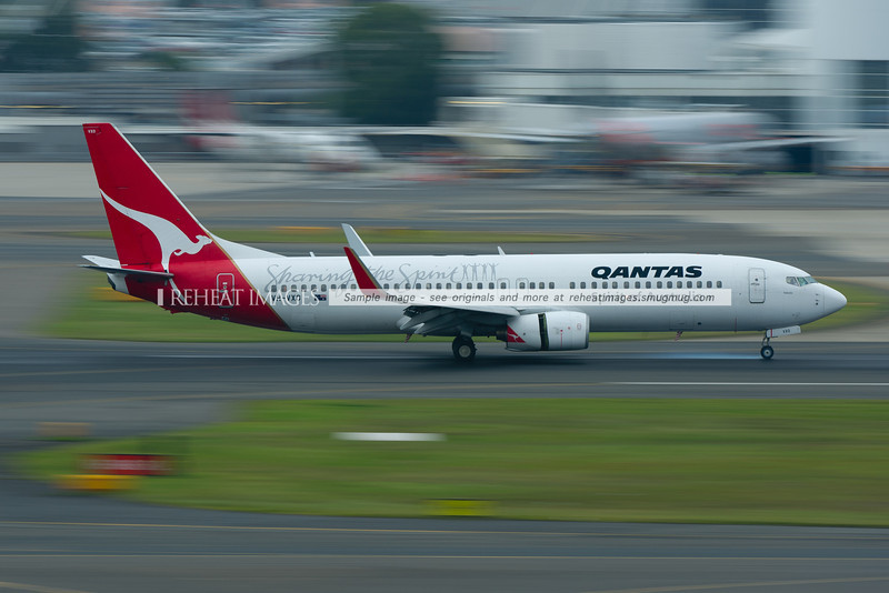 "A Qantas Boeing 737-838 lands at Sydney airport. The plane wears a special motif ""Sharing the Spirit""."
