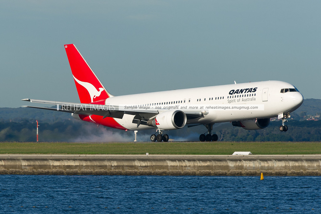A Qantas Boeing 767-338/ER lands at Sydney airport on runway 34 right.