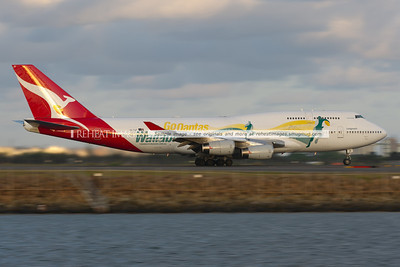 Qantas' special coloured B747 VH-OJO in the Go Qantas Wallabies colour scheme leaves Sydney Airport operating flight QF1.
