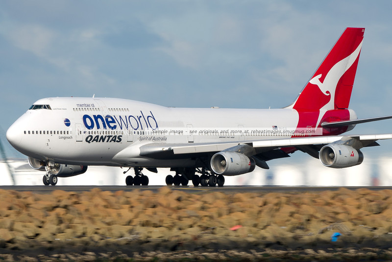 Qantas' OneWorld logojet, A B747-438 'VH-OJU', also known as 'Lord Howe Island' departs Sydney airport as flight QF6020 - headed for Johannesburg to replace another B747-438 which suffered mechanical difficulties.