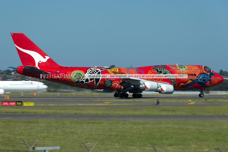 "Qantas B747-438/ER ""Wunala Dreaming"" arrives in Sydney as QF8 from Dallas, via Brisbane."