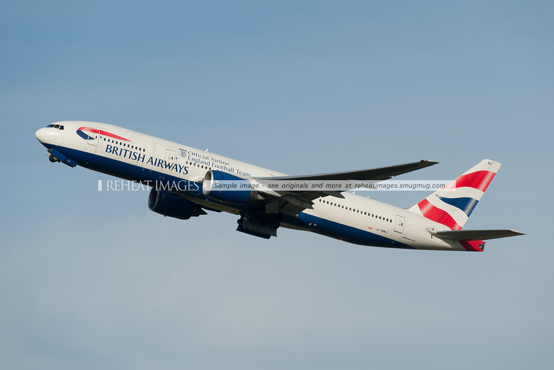 A British Airways Boeing 777-236/ER leaves Sydney airport. This plane is wearing a special motif indicating that British Airways is the official airline of the England Football Team.
