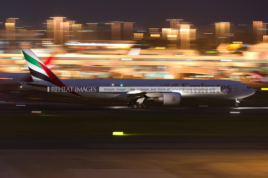 Emirates B777-300/ER is seen departing Sydney airport at night.