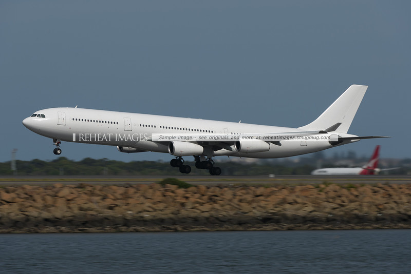 Airbus A340-300 CS-TQL leaves Sydney airport.