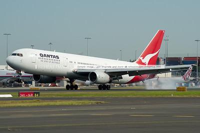 A Qantas B767-336 lands at Sydney airport.