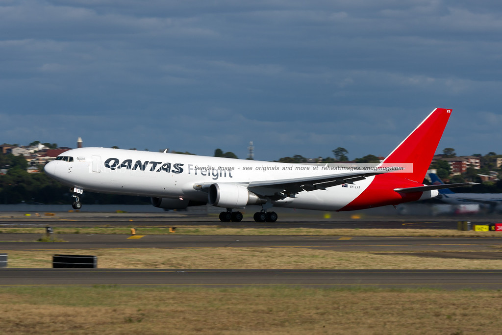 A Qantas Freight (Express Freighters Australia) Boeing 767-381F/ER departs Sydney airport on runway 16 right. This was the inaugural Qantas Freight service. The plane flew to Auckland.