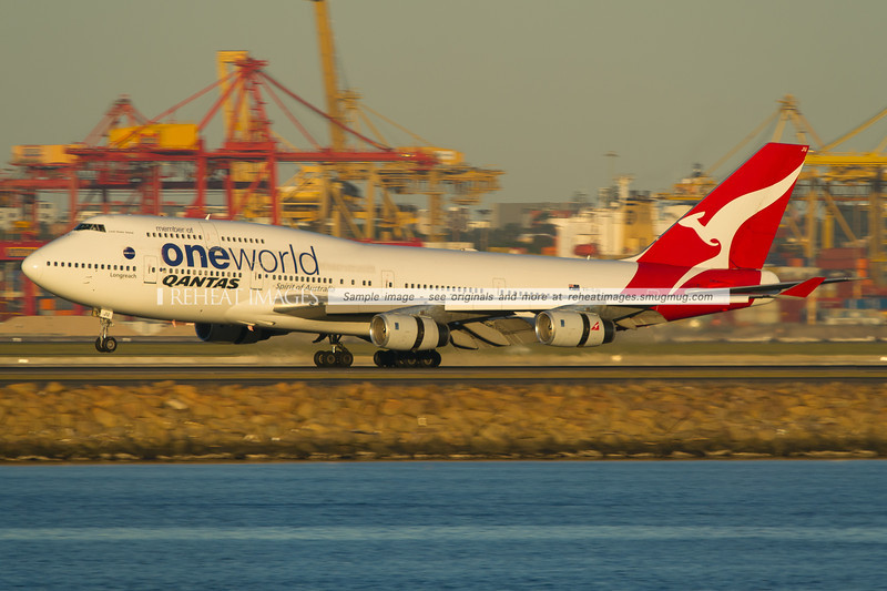 A Qantas B747-438 VH-OJU lands at Sydney airport on runway 34 left.