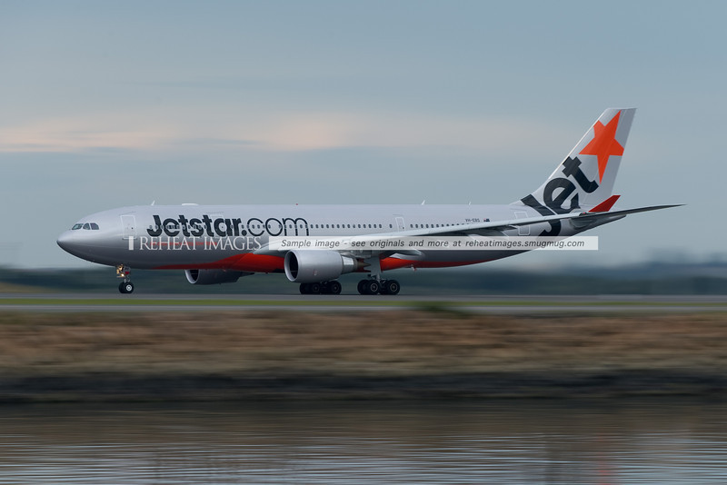 The Jetstar Airbus A330 VH-EBS  takes off from Sydney airport on runway 34 left. The plane has the Jetstar.com logotype at the front in black now.
