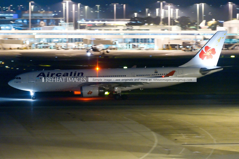 Air Calin leaving Sydney airport late at night. The plane is heading for runway 16R.