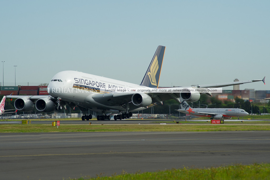 A Singapore Airlines Airbus A380-841 9V-SKQ lands right-wing-down on runway 16 right to counter the crosswinds.