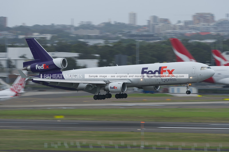 A FedEx MD-11 lands at Sydney airport.