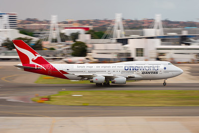 A Qantas Boeing 747-438 in OneWorld alliance colour scheme leaves Sydney Airport.