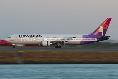 Hawaiian Boeing 767 seen at dusk in Sydney airport.