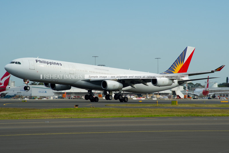 A Philippines A340-300 lands on runway 16 right at Sydney airport.