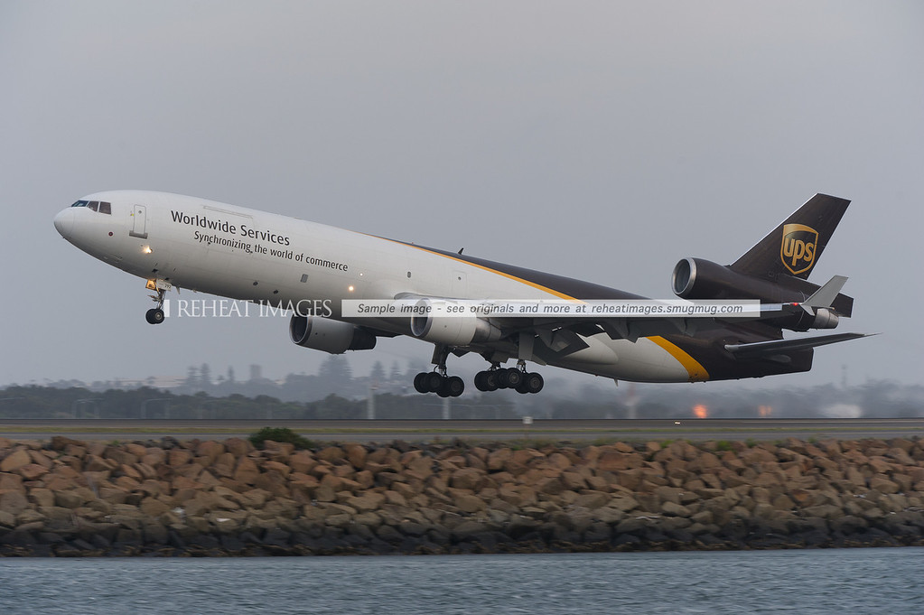 UPS McDonnell-Douglas MD11F takes off with vapour forming over its wings.