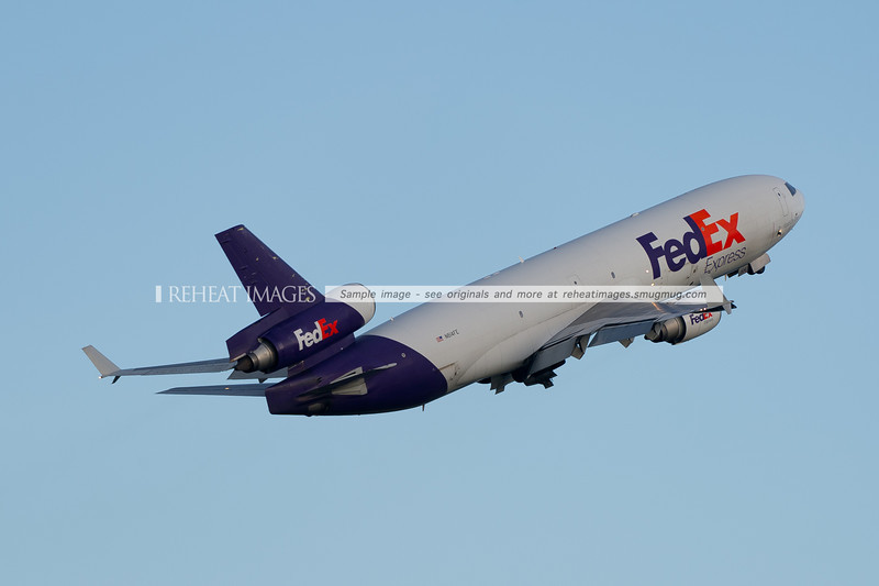 FedEx MD-11F also climbing steeply away from Sydney airport, just like the rival UPS MD-11F.