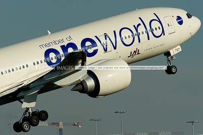 Japan Airlines Boeing 777-246/ER in the OneWorld colour scheme takes off from Sydney airport.