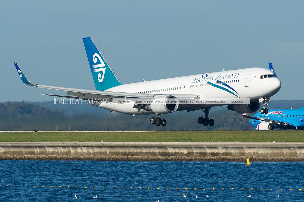 Air New-Zealand Boeing 767-319/ER fitted with winglets lands on runway 34 right at Sydney airport.