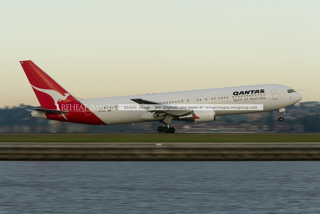 A Qantas Boeing 767-338/ER takes off from runway 34 right at Sydney airport.