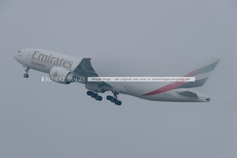 A6-EFF Emirates SkyCargo B777-F1H leaves Sydney as EK9825 in heavy fog.