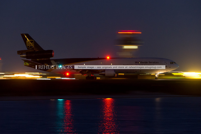 A UPS MD-11F leaves Sydney. The plane was so dark it was merely a silhouette - but 1/2sec shutter speed and ISO5000 can always solve that problem.