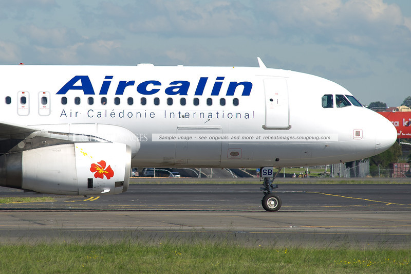 Aircalin Airbus A320 waiting to continue taxiing at Sydney airport.