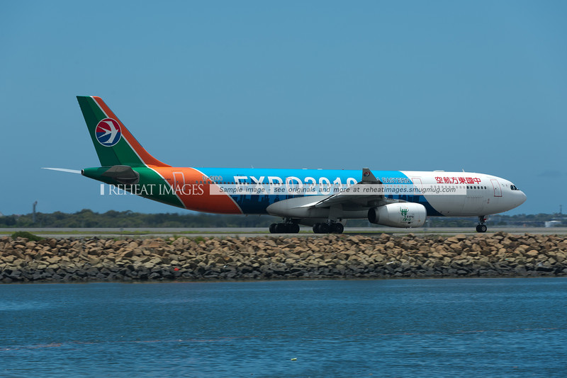 China Eastern Airbus A330 in the Expo 2010 colour scheme departs Sydney.