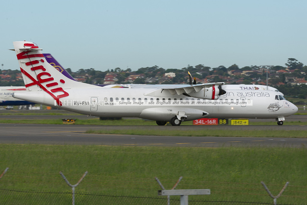 Virgin Australia ATR 72-500 at Sydney airport is taxiing with the left engine shut-down.