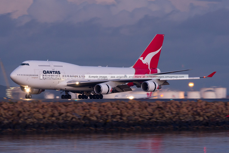 A Qantas B747-438/ER has landed at Sydney Airport.