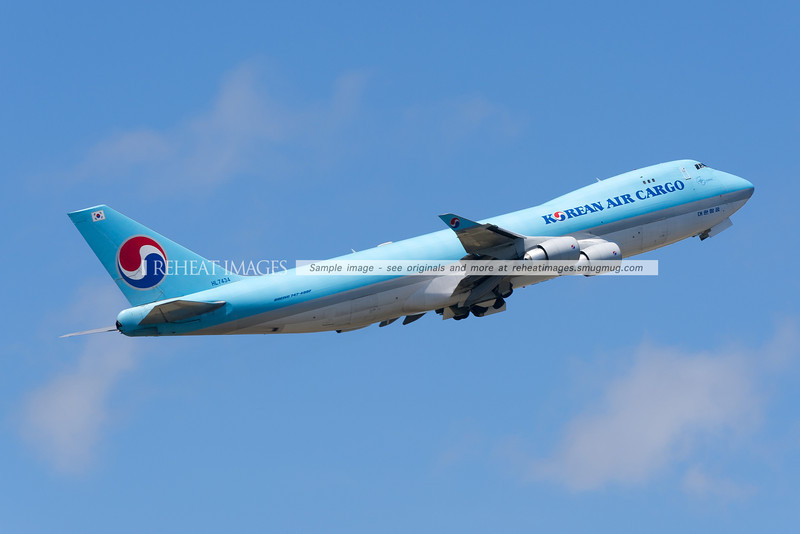 A Korean Air Cargo Boeing 747-4B5F leaves Sydney airport on runway 16 right.