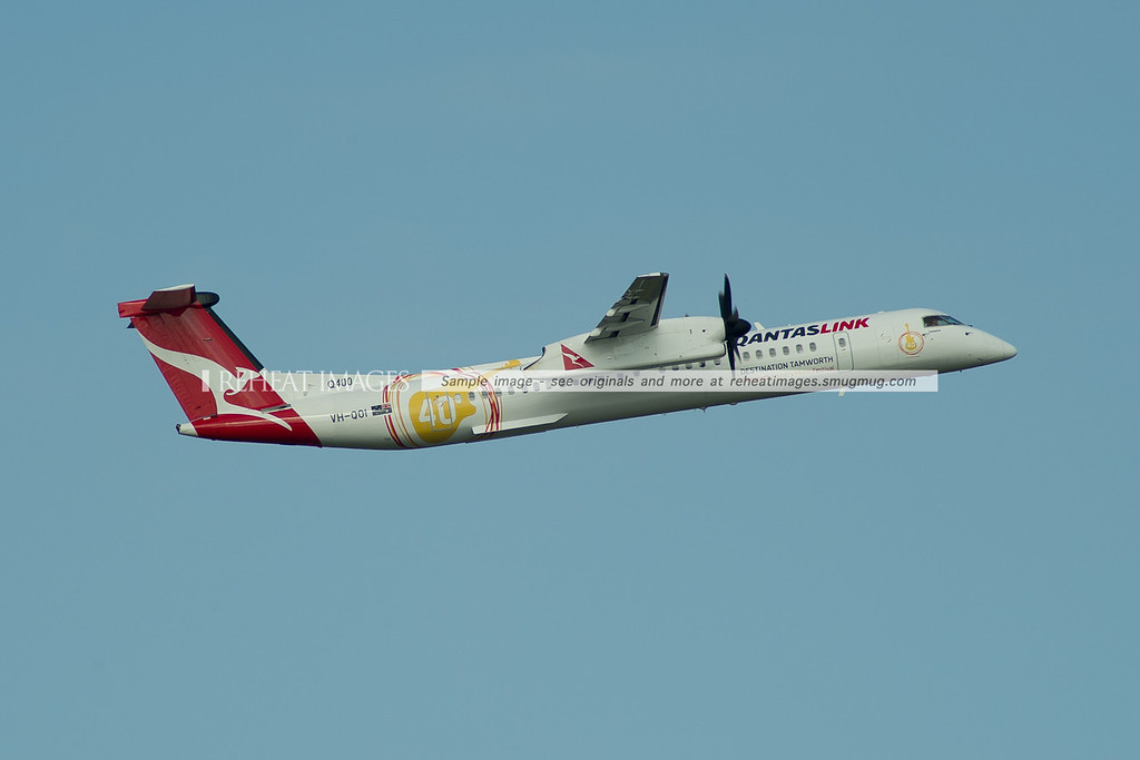 QantasLink Dash 8 Q400 VH-QOI is seen hear wearing some additions to its colour scheme promoting the Tamworth Country Music Festival.