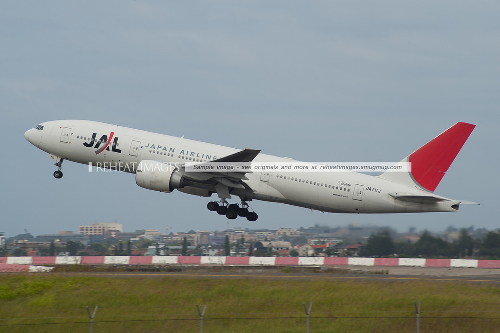JAL772, Boeing 777-200/ER taking off for the second time this morning, after aborting its first take off due to a runway incursion incident involving the super-jumbo aircraft of another airline.