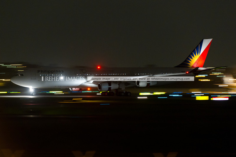A Philippines Airbus A340-300 arrives in Sydney airport at night.