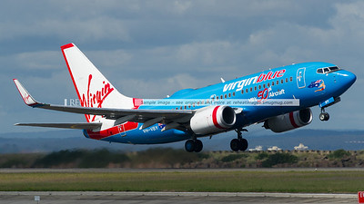 """Virgin Blue B737-700 """"Virginia Blue"""" takes off from runway 34 left at Sydney airport."""