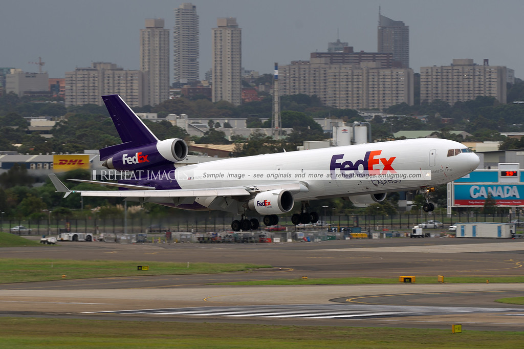 A Fedex McDonnell Douglas MD-11F arrives at Sydney airport on runway 16 right.