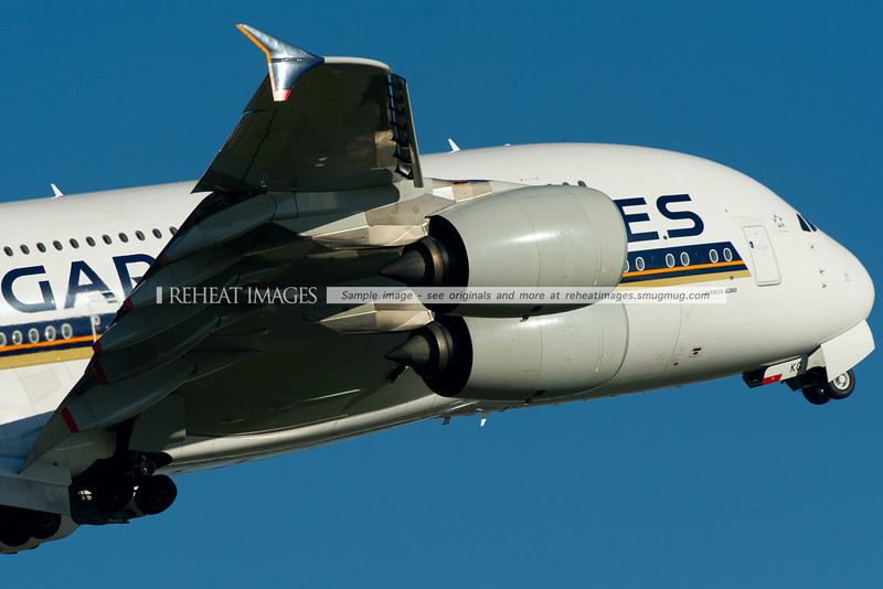A Singapore Airlines Airbus A380 climbs away from Sydney airport after taking off from runway 34 left.