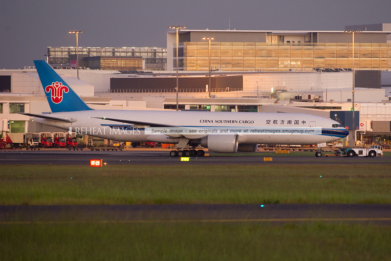 China Southern B777-F1B at Sydney airport being towed to the cargo ramp at dawn. This is the first China Southern B777F to visit Sydney airport.