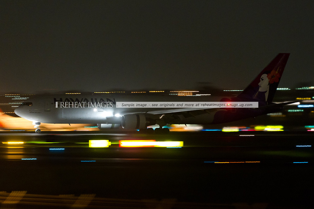 A Hawaiian Boeing 767-300/ER arrives in Sydney at night.