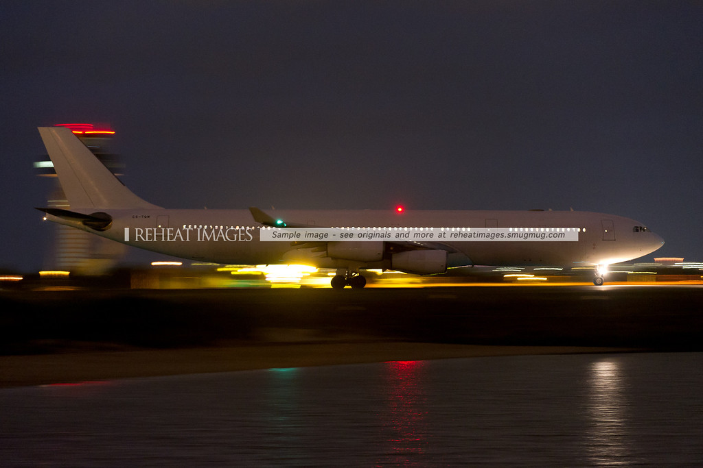 CQ-TQM departs Sydney at night. It arrived from Brisbane earlier in the evening. It is seen here taxiing out to runway 34 left.