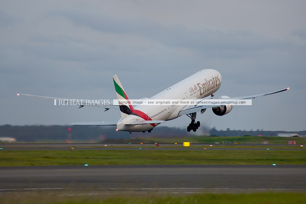 Emirates Boeing 777-300/ER takes off from runway 16 right at Sydney airport.