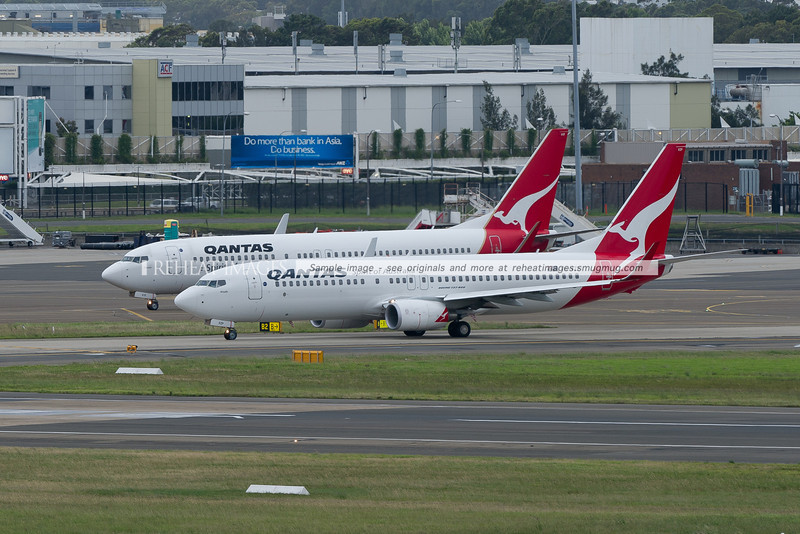 A pair of Qantas B737-838 aircraft wait for takeoff clearance at Sydney airport.