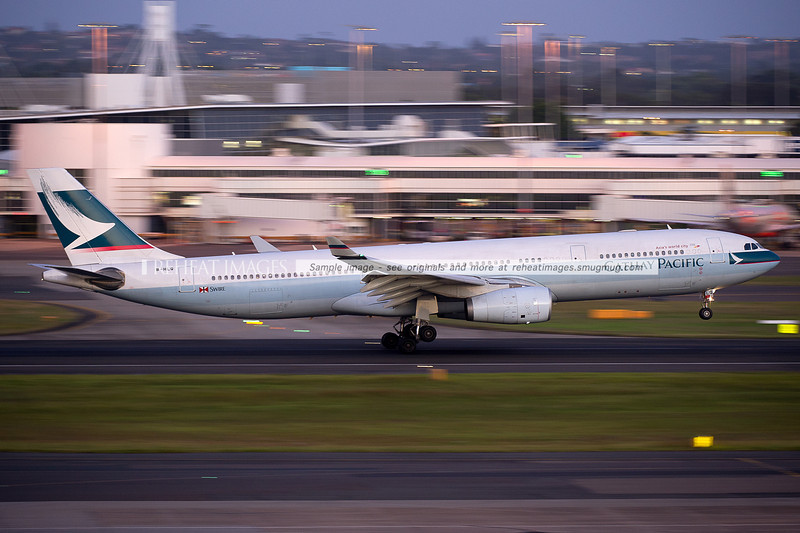 A Cathay Pacific A330-343X lands at Sydney airport on runway 16 right.