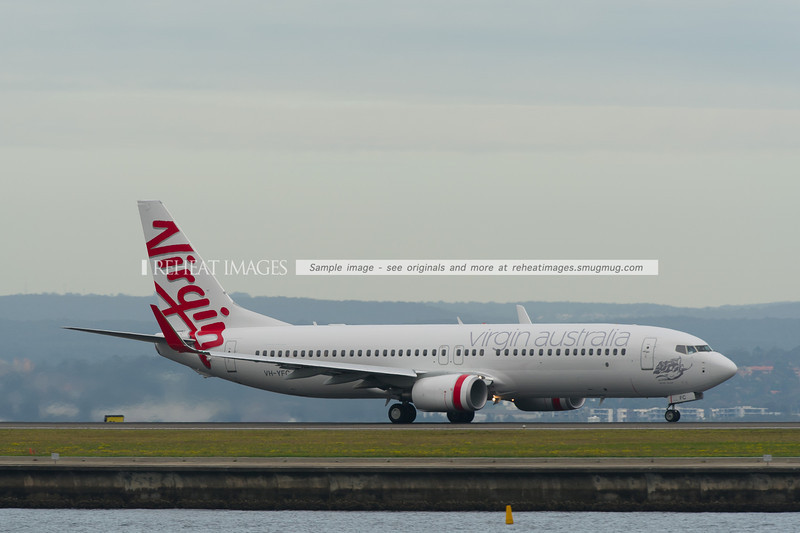 Virgin Australia B737-81D takes off from Sydney airport.