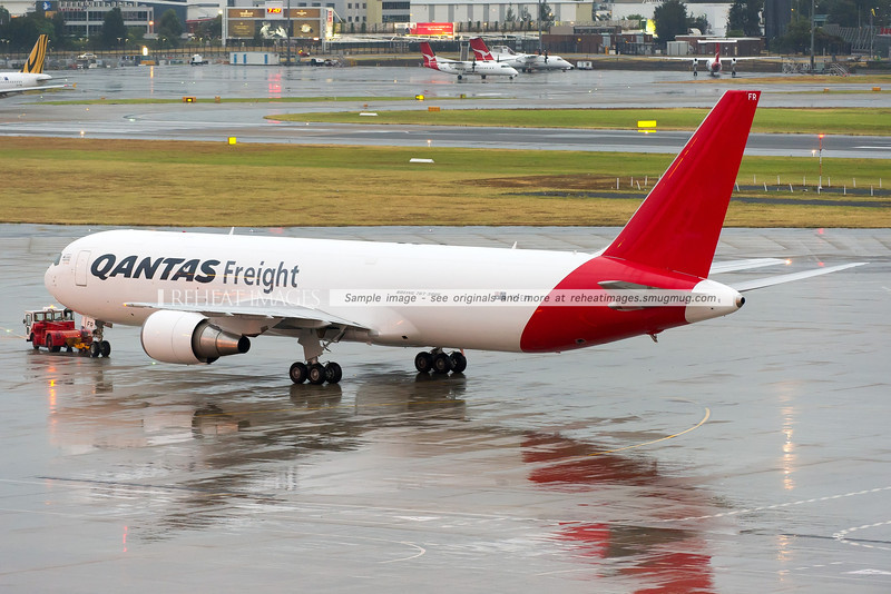 The Qantas Freight (Express Freighters Australia) Boeing 767-381F/ER in Sydney airport. It is shown here being towed away after arriving for the first time in Sydney on a rainy evening.