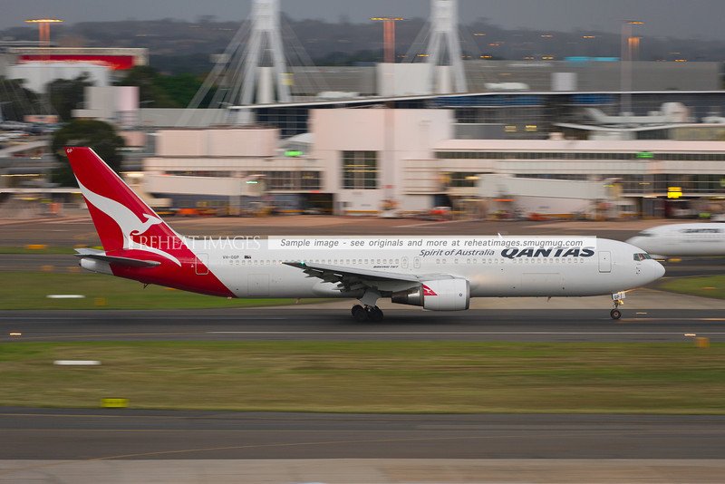 Qantas B767-338/ER takes off from Sydney airport in gloomy weather.